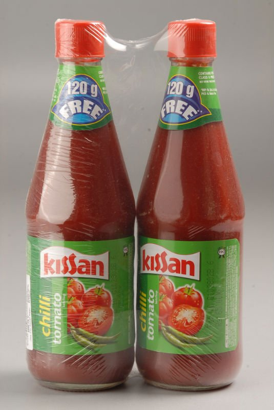 kissan tomato ketchup Kissan tomato ketcupkissan is a brand of hindustan unilever company which produces various product kissan manufactures diffrent kind of ketchup according to peoples choice, for those who do not like garlic and onion they have no garlic no onion, for those who like spicy they have tamat.