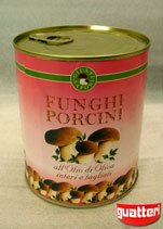 Canned whole and sliced Boletus Edulis mushrooms in olive oil