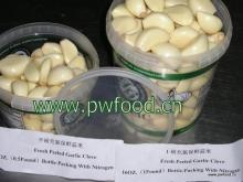 Peeled garlic in plastic box