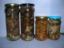 canned mushroom marinated in glass jars