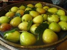 Figs soaking in brine with grape leaves