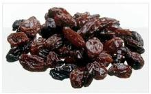 Sun dried dark brown raisin